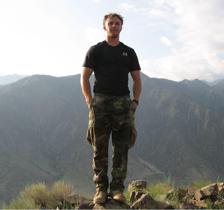 Robert standing on a mountain